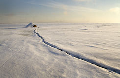 First Sunshine on the Saint Lawrence river in the winter morning Royalty Free Stock Photo
