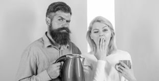 First thing they do every morning prepare hot drink. Get energy charge favourite hot drink. Enjoying morning coffee. Man. With electric teapot and women with stock photos
