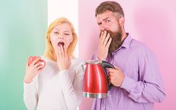 First thing they do every morning prepare hot drink. Get energy charge favourite hot drink. Enjoying nice morning. Together. Man with electric kettle and women stock photo