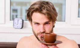 First thing in morning. Best time to have your cup of coffee. Every morning with his coffee. Man bearded handsome macho royalty free stock image