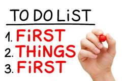 First Things First To Do List. Hand writing First Things First in To Do List with red marker isolated on white Stock Photos