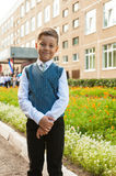 The first time in first class. Happy schoolboy at school background royalty free stock photography