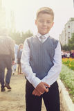 The first time in first class. Happy schoolboy at school background royalty free stock image