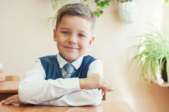 The first time in first class. Happy schoolboy at school desk. Begining of learning Royalty Free Stock Image