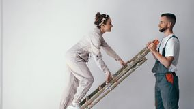 First time homeowners moving and folding down ladder. Excited first time homeowners moving and folding down ladder in their apartment after finishing their fist stock footage