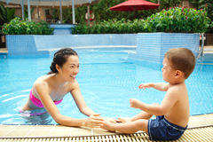 First time in the swimming pool Stock Image