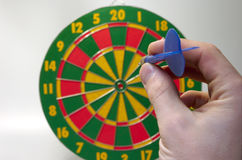 First try. Throwing first arrow (darts Stock Image