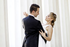 First Wedding Dance. Young newlyweds couple dancing their first waltz at the wedding Royalty Free Stock Photos