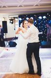 First wedding dance of newlywed couple in restaurant Stock Images