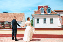 First wedding dance.wedding couple dances on the roof. Wedding day. Happy young bride and groom on their wedding day. Royalty Free Stock Images