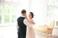 First wedding dance.wedding couple dances on the studio Wedding day. Happy young bride and groom on their wedding day. Stock Photos