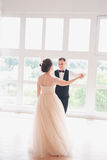 First wedding dance.wedding couple dances on the studio. Wedding day. Happy young bride and groom on their wedding day. Wedding co. Uple - new family. Wedding Royalty Free Stock Image