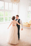 First wedding dance.wedding couple dances on the studio. Wedding day. Happy young bride and groom on their wedding day. Wedding co. Uple - new family. Wedding Royalty Free Stock Photo