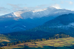First winter snow and autumn mountain Stock Image