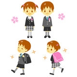 First year elementary school student. School boy and  girl, school bags,  file Royalty Free Stock Image
