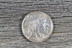 First year of original United States Buffalo Nickel on rustic wo Royalty Free Stock Photography