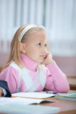 First year schoolgirl on lesson Royalty Free Stock Images