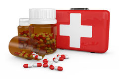 Firstaid. Bottles of medicinal capsules and red suitcase Royalty Free Stock Images