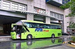 FirstCoach long distance bus at the Velocity Novena Square. Novena, Singapore - February 21, 2017: A FirstCoach long distance bus is ready at the Velocity Novena Royalty Free Stock Images