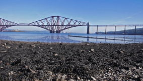 Firth of Forth Bridge in Scotland. Train crossing the irth of Forth Bridge in Scotland near Edinburgh stock video