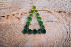 Firtrees made with quilling technique on a wooden surface Stock Images