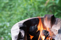 Firy on the traditional stove. Traditional stove use charcoal from real wood to setting up the frame Royalty Free Stock Photography