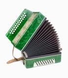 Fisarmonica verde, isolata su priorità bassa bianca Fotografia Stock