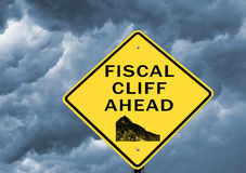 Fiscal cliff. Warning sign with storm in background Royalty Free Stock Photos