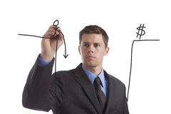 Fiscal Cliff. A young, tired businessman draws his idea of the coming fiscal cliff Stock Photography