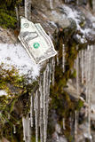 Fiscal cliff. One dollar bill on the edge of a slippery cliff. concept for fiscal cliff Stock Image