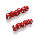Fiscal cliff represented with red dice. Red dice or cubes with text of Fiscal Cliff on white background Stock Photos