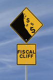 Fiscal Cliff Road Sign. A modified road sign showing the dollar currency falling off a cliff Royalty Free Stock Photo