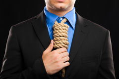 Fiscal pressure. Businessman with a rope in place of a collar, tax pressure concept Stock Image