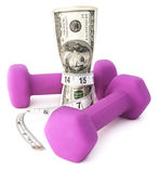 Fiscally Fit. Dumbbells with a measuring tape and cash depicting financial wellness Royalty Free Stock Photography