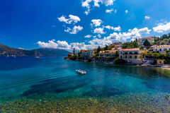 Fiscardo on the Island of Kefalonia in Greece. The holiday destination. Beautiful beach with turquoise water near Fiskardo, Kefalonia, Greece Royalty Free Stock Photo