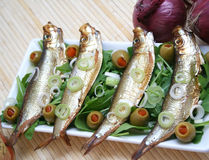 Fisch. Some fish with salad and olives royalty free stock photos