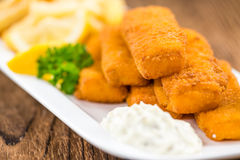 Fisch Sticks (close-up shot) on an old wooden table stock photos