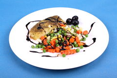 Fisch with vegetables and balsamic cream Stock Images
