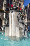Fischbrunnen fountain in front of the New City Hall of Munich at Stock Images