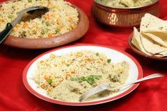 Fische in der grünen Currymahlzeit Stockfotos