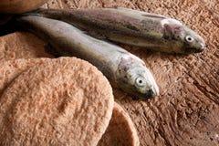 Fische und Brot Stockfotografie