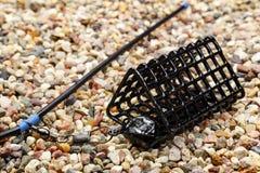 Fischenfuttertrog mit Zusatz für das Fangen durch eine Zufuhr Lizenzfreies Stockbild