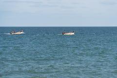 Fischer auf Arbeit Stockfoto