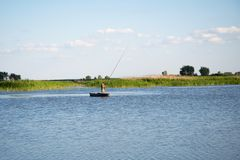 Fischer auf Boot Lizenzfreies Stockfoto