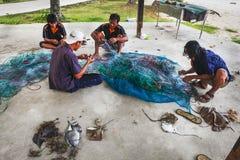 Fischer auf dem abgebauten Fang Stockfoto