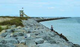 Fischer auf der Küste Lizenzfreie Stockbilder