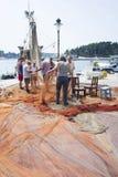 Fischer auf Dock Stockbilder