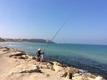 Fischer auf Strand in Tel Aviv, Israel Stockfoto