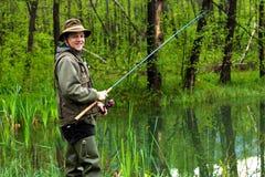 Fischer in der Aktion Lizenzfreie Stockfotos