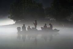 Fischer in einem Boot Stockfotografie
